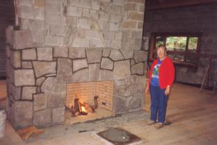 Fern Anderson lights the first fire