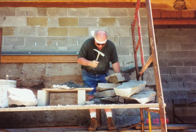 George Milne cutting stone
