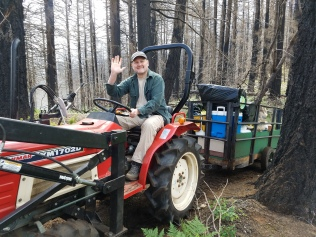 Tim on the new tractor which he bought for the club